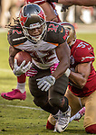 San Francisco 49ers inside linebacker Michael Wilhoite (57) tackles Tampa Bay Buccaneers running back Jacquizz Rodgers (32) on Sunday, October 23, 2016, at Levis Stadium in Santa Clara, California. The Buccaneers defeated the 49ers 34-17.