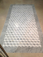 Euclid, a stone Ready to Ship pattern, shown in Paperwhite, Carrara, Thassos polished with a Carrara border.<br /> -photo courtesy of Ceramic Matrix, Delray Beach