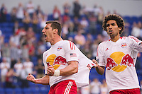 Kenny Cooper (33) of the New York Red Bulls celebrates scoring with Mehdi Ballouchy (10) during the first half against the Houston Dynamo during a Major League Soccer (MLS) match at Red Bull Arena in Harrison, NJ, on May 09, 2012.
