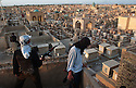 NAJAF, IRAQ-APRIL 20: Soldiers of the Al-Medhi Army stand guard at their defensive position overlooking the Najaf cemetary April 20, 2004 inside the holy Iraqi Shia City of Najaf. The Al-Medhi Army, a militia loyal to firebrand Shia cleric Moqtada al-Sadr, has vowed to repel what they believe is an impending attack by U.S. forces on the city of Najaf. Some 2,500 U.S. soldiers sit just north of the city and have vowed to crush the militia and capture or kill al-Sadr.  (Photo by Scott Nelson/Getty Images. ..