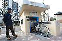 Apr. 30, 2010 - Tokyo, Japan - A parking guard looks at a bicycle reay to enter into the elevator of an automated underground parking in Tokyo, Japan, on April 30, 2010. The Sugiyama Park Subway Bicycle Parking opened on April 20 and can store up to 250 bicycles. It costs 2,500 yen for a monthly ticket to use. Starting May 1, users who will park their bicycle in illegal spaces near Shin Nakano station will be ticketed.