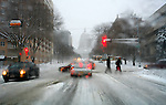 Spring snow storm slows traffic in Madison Wisconsin.
