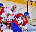 21 December 2008: Carolina Hurricanes' goaltender Cam Ward gives up his first goal of the game to Montreal Canadiens' right wing forward Matt D'Agostini in the second period at the Bell Centre in Montreal, Quebec, Canada. The Hurricanes defeated the Canadiens 3-2 in overtime. ***** Editorial Sales Only ***** Mandatory Photo Credit: Ed Wolfstein Photo