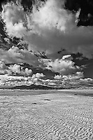 Rippled sand sets off this high contrast black and white image taken in eastern Ireland.