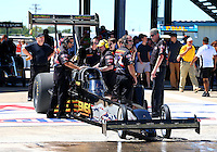 Sept. 21, 2013; Ennis, TX, USA: Crew members for NHRA top fuel dragster driver Troy Buff during the Fall Nationals at the Texas Motorplex. Mandatory Credit: Mark J. Rebilas-