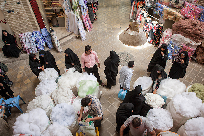 Business as usual at Yazd Bazaar. The old city bazaar is one of the best places in Iran to buy termeh or tirma (local silk weaving), brocade, glassware and cloth that once brought the town its prosperity in centuries past. As part of the ancient trade route known as silk road, Marco Polo also pass Yazd during his journey.