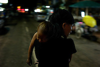 Vientiane, Laos, August 11, 2007.Many single mothers in Vientiane have to work in bars or discos to raise their children.