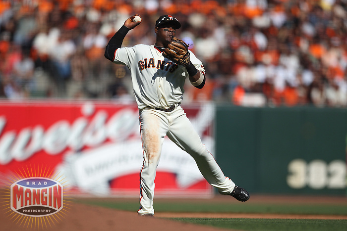 SAN FRANCISCO - October 2:  Juan Uribe of the San Francisco Giants makes a play at shortstop against the San Diego Padres during the game at AT&T Park on October 2, 2010 in San Francisco, California. (Photo by Brad Mangin)