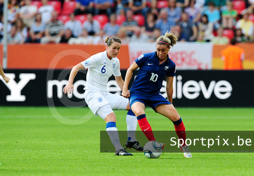Fifa Women's World Cup Germany 2011 : England - France - at Leverkusen :  Camille Abily aan de bal voor Casey Stoney.foto DAVID CATRY / Vrouwenteam.be