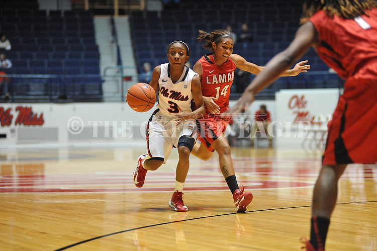 Ole Miss' Valencia McFarland (3) vs. Lamar's Carenn Baylor (14) in women's college basketball at the C.M. &quot;Tad&quot; Smith Coliseum in Oxford, Miss. on Monday, November 19, 2012.  Lamar won 85-71.