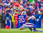 9 November 2014: Kansas City Chiefs running back Jamaal Charles completes a 17-yard rush up the middle, tackled by Buffalo Bills cornerback Corey Graham, in the second quarter at Ralph Wilson Stadium in Orchard Park, NY. The Chiefs rallied with two fourth quarter touchdowns to defeat the Bills 17-13. Mandatory Credit: Ed Wolfstein Photo *** RAW (NEF) Image File Available ***