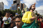 Believers attend the San Judas Tadeo day outside the San Hipolito church in Mexico City. Thousands of people arrive at the church to pay homage to San Judas Tadeo for alleged miracles.  Photo by Heriberto Rodriguez
