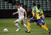 New Zealand's Shane Smeltz is chased by Solomon Islands' Nelson Sale Kilifa, left, and Himson Teleda in a FIFA World Cup Qualifier Match, North Harbour Stadium, Auckland, New Zealand, Tuesday, September 11, 2012.  Credit:SNPA / David Rowland