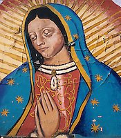 The peeling paint and drowsy eyes of  this mural of the Virgin of Guadalupe at a gas station east of El Paso,Texas create a pensive mood.