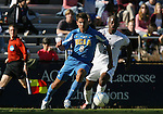 UCLA's Sal Zizzo (l) pushes past Duke's Kyle Helton (r) on Sunday, November 26th, 2006 at Koskinen Stadium in Durham, North Carolina. The University of California Los Angeles Bruins defeated the Duke University Blue Devils 3-2 in sudden death overtime in an NCAA Division I Men's Soccer Championship quarterfinal game.