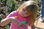 Girl and Julia Heliconia butterfly at the Living Desert