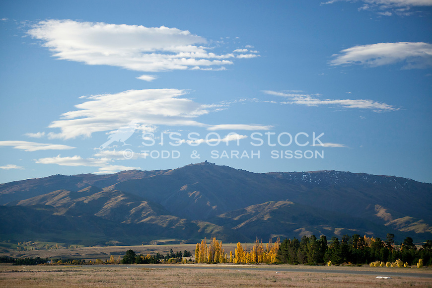 Leaning Rock on the Dunstan Range, taken on a sunny, blue sky, autumn day fron the airport near Alexandra  in  Central Otago, South Island, New Zealand