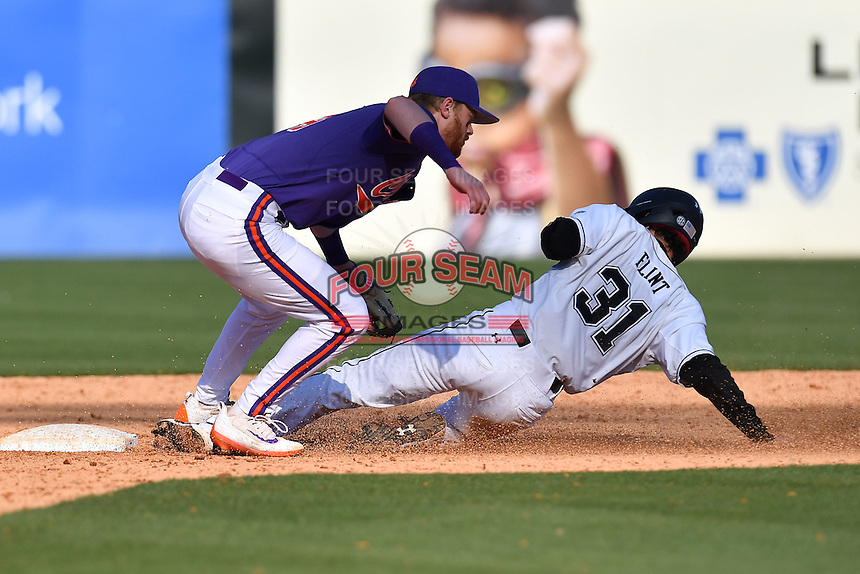 Shortstop Grayson Byrd (4) of the Clemson Tigers tags out Christian Flint (31) of the South Carolina Gamecocks on Saturday, March 4, 2017, at Fluor Field at the West End in Greenville, South Carolina. Clemson won, 8-7. (Tom Priddy/Four Seam Images)