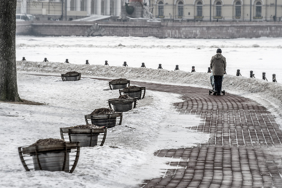 ST. PETERSBURG - CIRCA MARCH 2013: People walking in Zayachy Island, Saint Petersburg, circa March 2013. This is a popular tourist destination with 221 museums, 2000 libraries, and 80  plus theaters within the city.