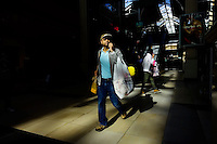 Customers walk carrying stores bags during Black Friday sales events in Jersey City, NJ.  11/27/2015. Eduardo MunozAlvarez/VIEWpress