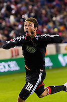 Nick DeLeon (18) of D. C. United celebrates scoring the game winning goal. D. C. United defeated the New York Red Bulls 1-0 (2-1 in aggregate) during the second leg of the MLS Eastern Conference Semifinals at Red Bull Arena in Harrison, NJ, on November 8, 2012.