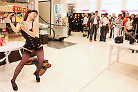 25/8/2010.  Renowned Burlesque Artist Kitty Bang Bang is pictured performing a burlesque dance in the Cosmetics Hall of Brown Thomas Dublin to celebrate the exclusive arrival of fragrance house Penhaligon's to Brown Thomas.  Picture James Horan/Collins