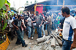 Dominican Republic: A gun is drawn from a bodyguard as he becomes possessed by spirits at the compound of Bleo, a Vodú  priest and head of El GaGá de San Luis on the outskirts of Santo Domingo. ..At 38 years old he inherited the GaGá upon the death of his grandfather 10 years ago. He is promised to the GaGá for life and it must be continued by the eldest of his 3 children and grandchildren.