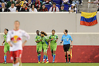 Fredy Montero (17) of the Seattle Sounders celebrates scoring the game's only goal with teammates. The Seattle Sounders defeated the New York Red Bulls 1-0 during a Major League Soccer (MLS) match at Red Bull Arena in Harrison, NJ, on May 15, 2010.