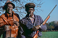Plains, GA. December 1976.<br /> Two men wearing hats stand with a gun. Hunting season for the people of Plains is very popular. The game they shoot provides meals for their families. Southerner Jimmy Carter is going to the White House. Born in Georgia, Carter is a democrat with a more open mind. A man who favors racial integration inspite of a majority of white people still living under misserable conditions. Officially, social barriers have been dropped, but racism still exists. If the South is on the rise and if in Georgia average salaries have trippled in the last 15 years, not everyone is benefitting from this economic boom. Perhaps, Jimmy Carter will seriously consider those who are in the lower end of the system's social scales.
