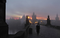 Dawn at the Charles Bridge or Karluv most, built 1357 - 15th century, looking towards the Old Town bridge tower, across the Vltava river in Prague, Czech Republic. Its construction began under King Charles IV, replacing the old Judith Bridge built 1158'??1172 after flood damage in 1342. This new bridge was originally called the Stone Bridge (Kamenny most) or the Prague Bridge (Prazsky most) but has been the Charles Bridge since 1870. The bridge is 621m long and nearly 10m wide, resting on 16 arches shielded by ice guards. It is protected by three bridge towers, two on the Lesser Quarter side and one in Gothic style on the Old Town side. The historic centre of Prague was declared a UNESCO World Heritage Site in 1992. Picture by Manuel Cohen