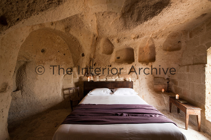 This bedroom at the unique Albergo Diffuso Le Grotte della Civita in Southern Italy is housed in one of the many restored caves