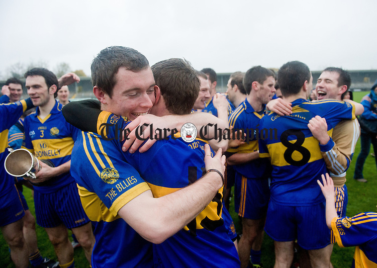 Newmarket players Niall Enright and Shane O Brien, front, embrace following the senior county hurling final at Cusack Park. Photograph by John Kelly.