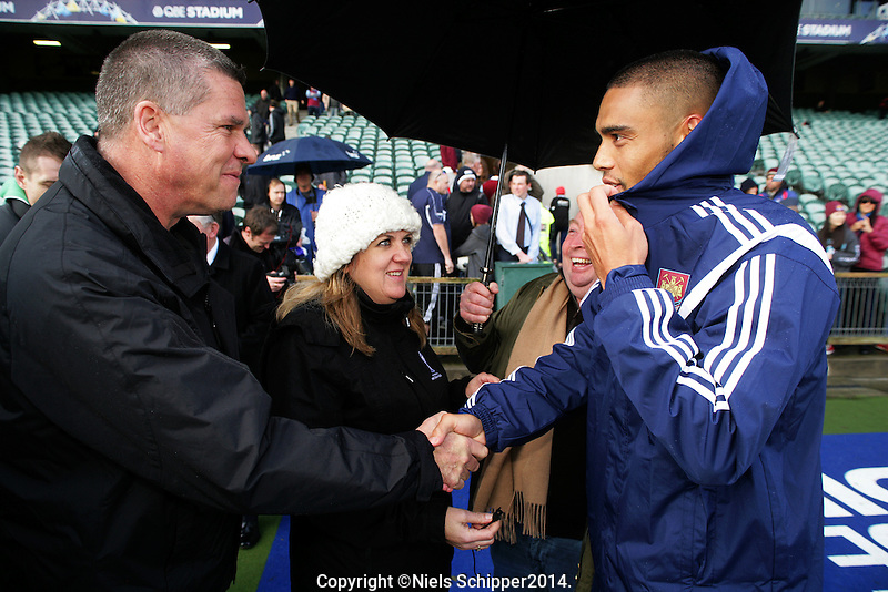 West Ham fan Miles Davis shakes hands with Winston Reid during the West Ham United football team training at North Harbour Stadium, Albany, New Zealand on Monday, 21 July 2014. Photo: Niels Schipper / lintottphoto.co.nz