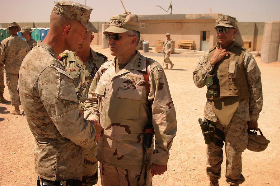 General George Casey shakes hands with Lt. Col. John Mayer on Aug. 29, 2004 as he congratulates him and his battalion - 1st Battalion 4th Marines - for their successes in their against the Mehdi Army during the Battle of Najaf.
