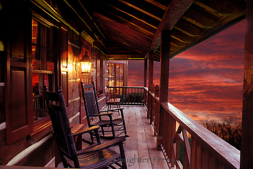 Porch on log home overlooking gorgeous sunset, Missouri, USA