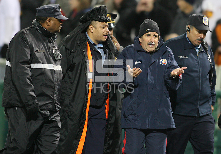 Rene Simoes head coach of Costa Rica is lead from the field by the police during a 2010 World Cup qualifying match in the CONCACAF region at RFK Stadium on October 14 2009, in Washington D.C.The match ended in a 2-2 tie.