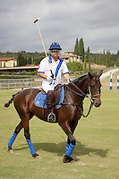 Italy. Tuscany. Polo Club Villa A Sesta is located near the village of Ripaltella and Pietraviva (Arezzo). Riccardo Tattoni is a polo player riding his horse before a polo game. The game is between the teams Villa A Sesta ( white, leaded by Ricardo Tattoni) and Los Nocheros (red). Riccardo Tattoni is the owner of Polo Club Villa A Sesta. 17.09.10 © 2010 Didier Ruef