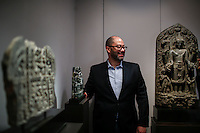 Nayef Homsi poses next to pieces of art at his gallery during the Asian Art Week in New York. 11.03.2015. Eduardo MunozAlvarez/VIEWpress.