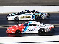 Nov 13, 2016; Pomona, CA, USA; NHRA pro stock driver Shane Gray (near) alongside Matt Hartford during the Auto Club Finals at Auto Club Raceway at Pomona. Mandatory Credit: Mark J. Rebilas-USA TODAY Sports