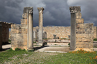 The House of the Columns, with pilasters and a spiral column with Corinthian capitals, Volubilis, Northern Morocco. Volubilis was founded in the 3rd century BC by the Phoenicians and was a Roman settlement from the 1st century AD. Volubilis was a thriving Roman olive growing town until 280 AD and was settled until the 11th century. The buildings were largely destroyed by an earthquake in the 18th century and have since been excavated and partly restored. Volubilis was listed as a UNESCO World Heritage Site in 1997. Picture by Manuel Cohen