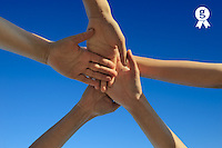 Five hands stacked, on blue sky (Licence this image exclusively with Getty: http://www.gettyimages.com/detail/103544604 )