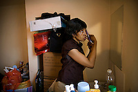 49 year old Anne brushes her hair before going to the Congolese church in North London who help her with food and a little money every now and again. She came to the UK from DR Congo in 2002 and claimed asylum. She had been detained and beaten for condemning the forced recruitment of child soldiers after her son was taken by rebel forces and her husband killed. On the second occasion she was raped by the rebels. After forming a women's group to protest against rebel activity she was forced to watch, paralysed with horror, as three of the women in her group were buried alive by the rebels. Following the rejection of her asylum claim Anne spent the next three years living in total destitution, much of the time sleeping outside. One night she was attacked by a white gang while she was sleeping on a park bench in Sunderland - two of the gang members raped her. She survived on an average of three GBP a week, or five on a good week. Anne is one of an estimated 300,000 rejected asylum seekers living in the UK.