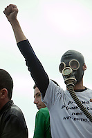 Moscow, Russia, 22/08/2010. .An ecological activist wearing a gas-mask in Pushkin Square, where some 3,000 people gathered for a concert and protest against the destruction of part of Khimki Forest in northern Moscow as part of a motorway project. The concert was banned and police seized the performers' musical equipment, but unusually the anti-government protest was allowed to take place, although a number of opposition organisers were arrested on their way to the demonstration.