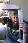 SOMERSET WEST, SOUTH AFRICA - MARCH 23: Pieter H. Waiser, the founder of Blank Bottle wine company, mixes a new blend in his office on March 23, 2010 in Somerset West, South Africa. Mr. Waiser buys bulk wine from different wineyards around Cape Town and mixes his own blends. He doesn't own a wine farm himself and operates from a small office on a farm. (Photo by Per-Anders Pettersson/Getty Images)