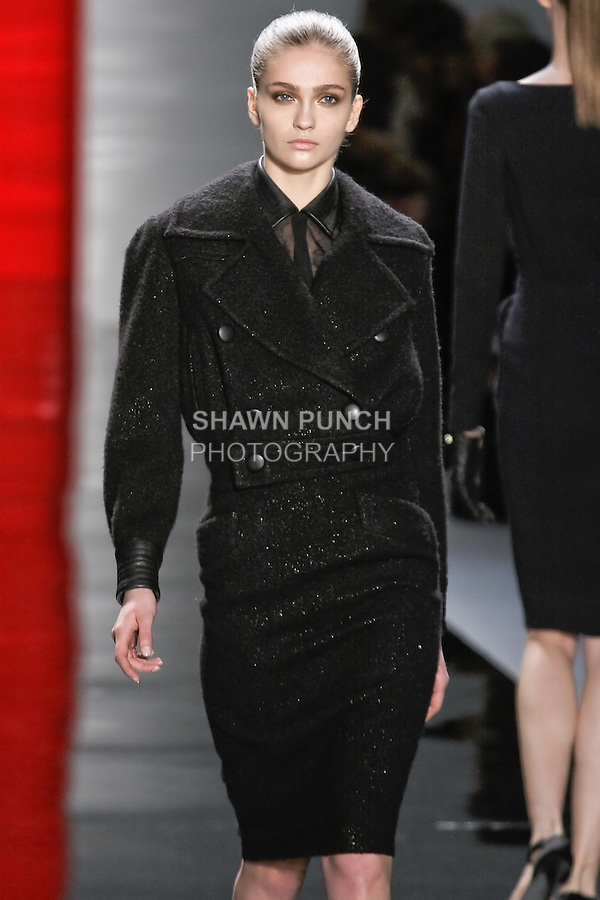 Ella walks runway in a ebony metallic boucle Eisenhower jacket with leather cuffs over silk chiffon and lace blouse and ebony slim boucle pencil skirt, from the Reem Acra Fall 2012 Feminine Power collection fashion show, during Mercedes-Benz Fashion Week New York Fall 2012 at Lincoln Center.