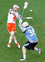 Virginia Cavaliers Matt White (6) shoots the ball over Johns Hopkins Nikhon Schuler (36) during the game in Charlottesville, VA. Johns Hopkins defeated Virginia 11-10 in overtime. Photo/Andrew Shurtleff