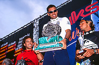 Sunny Garcia (HAW) with Derek Ho (HAW) and Victor Ribas (BRA) after winning the 1995 Quiksilver Pro France at the Grand Plage, Biarritz in the South West of France. Photo: joliphotos.com