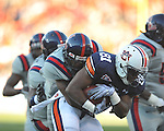 Auburn wide receiver Terrell Zachery (81) is tackled by Ole Miss cornerback Marcus Temple (4) and Ole Miss defensive tackle Ted Laurent (99) 9at Vaught-Hemingway Stadium in Oxford, Miss. on Saturday, October 30, 2010. Auburn won 51-31.
