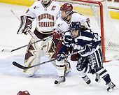 Meagan Mangene (BC - 24), Sarah Campbell (UNH - 26) - The Boston College Eagles and the visiting University of New Hampshire Wildcats played to a scoreless tie in BC's senior game on Saturday, February 19, 2011, at Conte Forum in Chestnut Hill, Massachusetts.