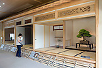 "A visitor looks at different styles of Japanese ""zashiki"" rooms, of which, at right, is the most prestigious of those, made in the shin style at the Saitama Omiya Bonsai Museum of Art in Saitama, Japan on 15 Aug. 2011..Photographer: Robert Gilhooly"